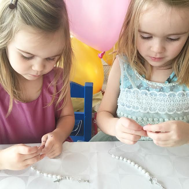 Children Making a Rosary Bracelet